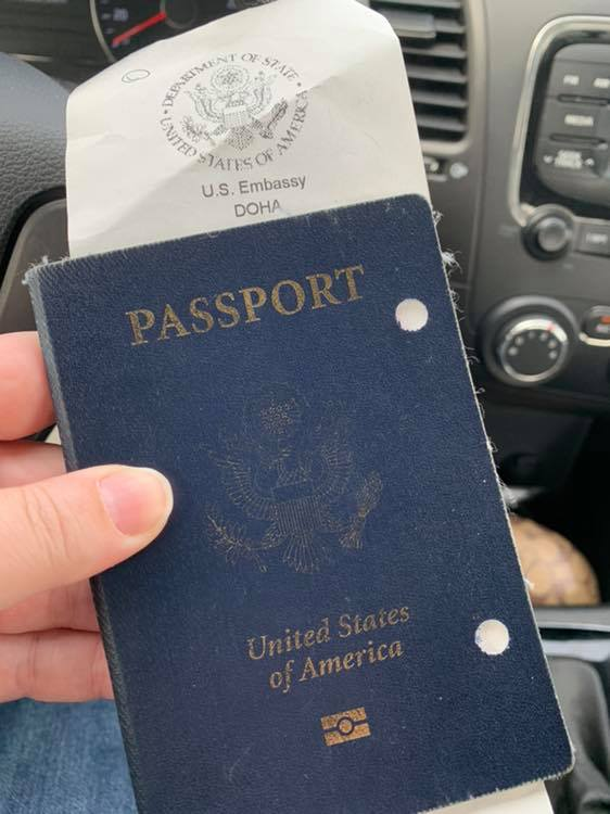 Amy holding her US Passport book