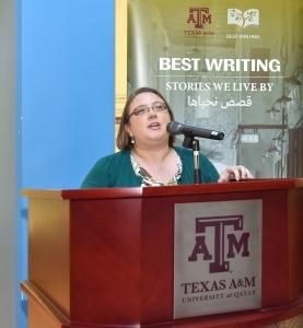 speaker at podium at Best Writing reception